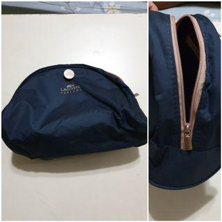 🚚 Lacoste Cosmetic pouch. Waterproof. Used.