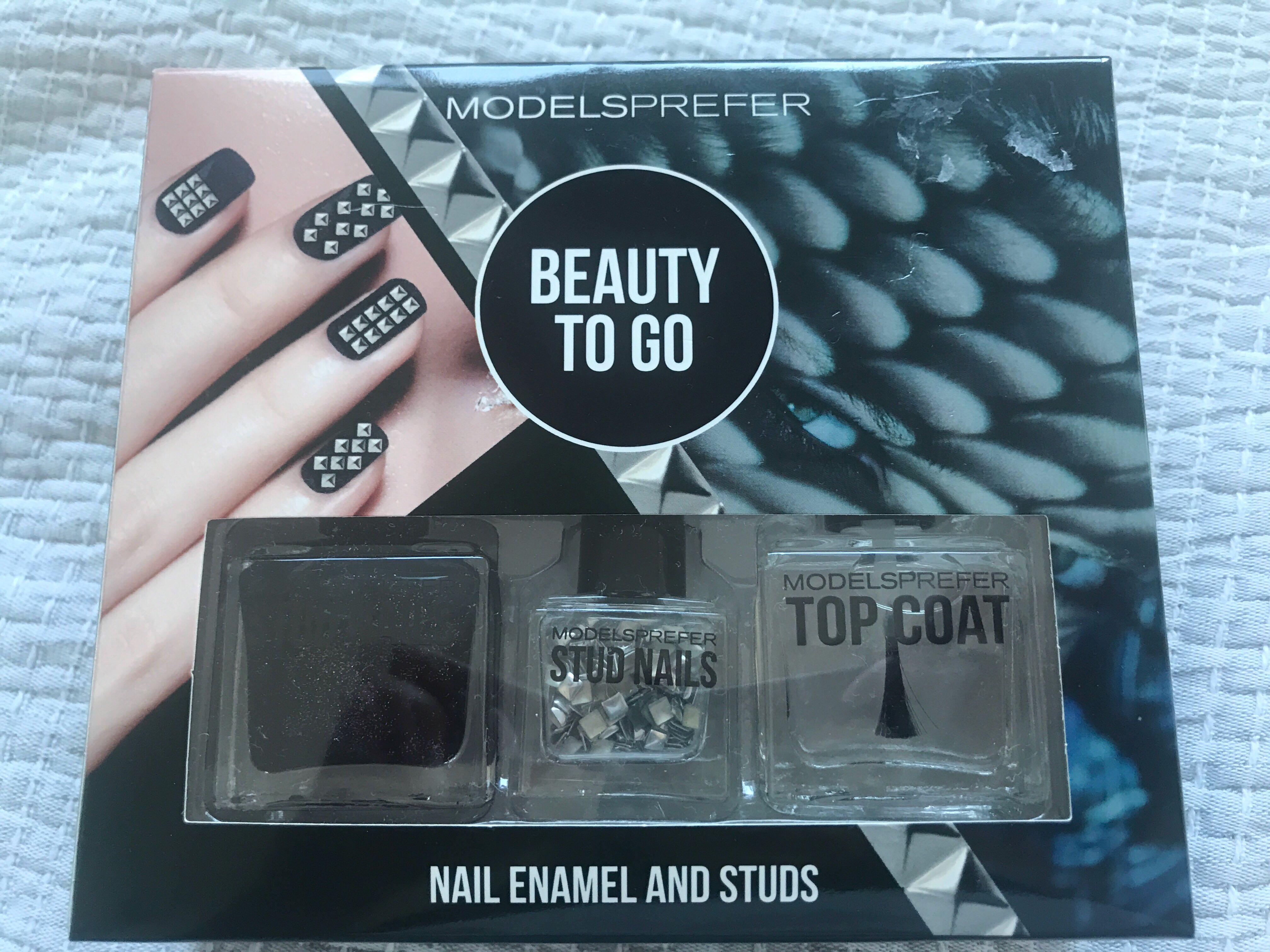 Modelsprefer nail enamel and studs + top coat heavy mental + silver studs