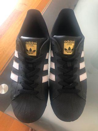 Adidas black superstars