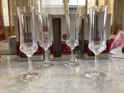 3 boxes of set of 4 Champagne crystal glasses