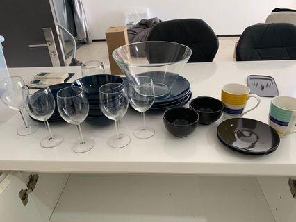 Plates bowls wine glass utensils