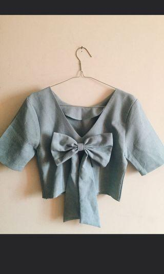 Blue top with ribbon