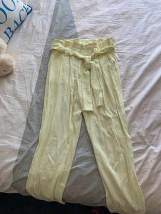 Yellow pants with tie up at the front
