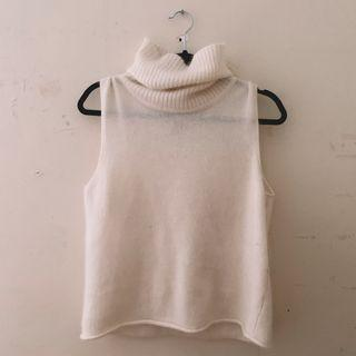 sleeveless cream turtleneck