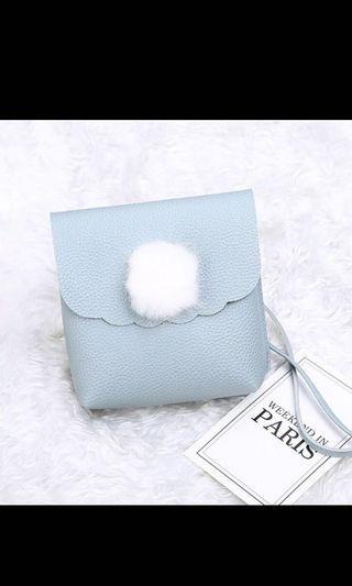 Bnip fluffy pom pom pastel blue sling bag