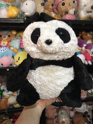 Reversible panda plush