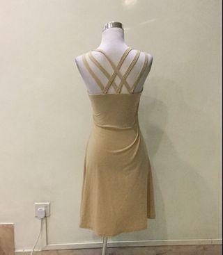 Criss cross back nude coloured dress
