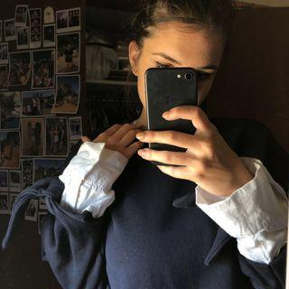 Navy jumper with shirt cuffs