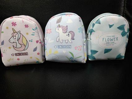 Back pack coin pouch