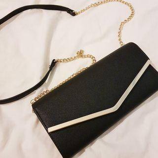 Colette black clutch bag
