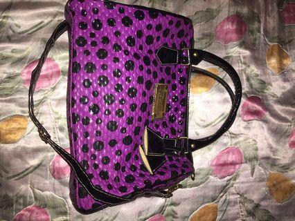 Purple bag with black dots