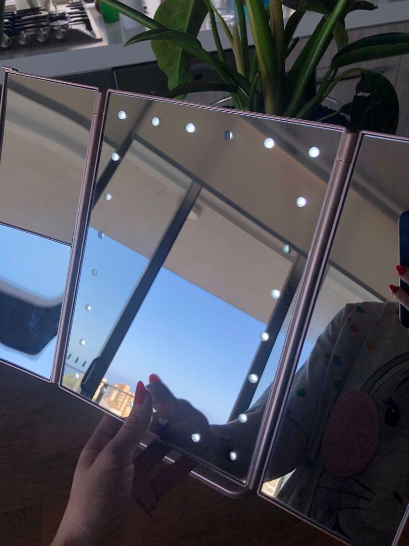 MAKEUP MIRROR: tri fold touch and glow dimmable led makeup mirror