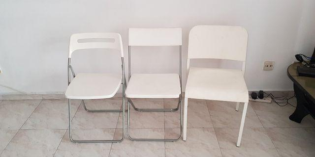 3 white chairs- each for SGD 5