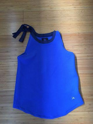 Plains and Print halter blue top with ribbon