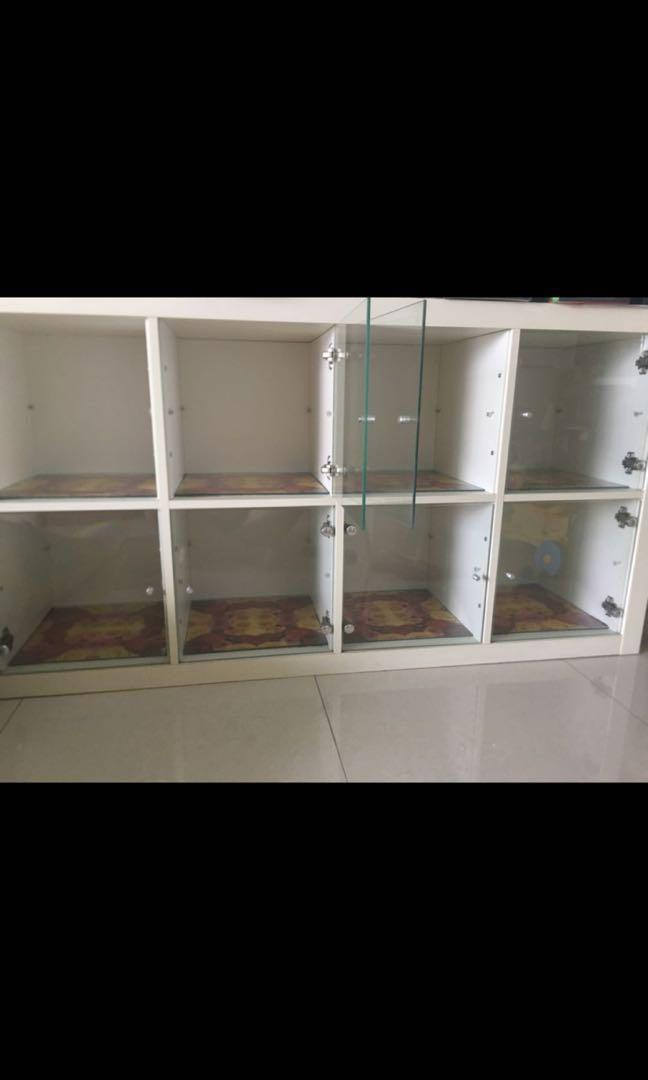 Two IKEA storages with glass doors