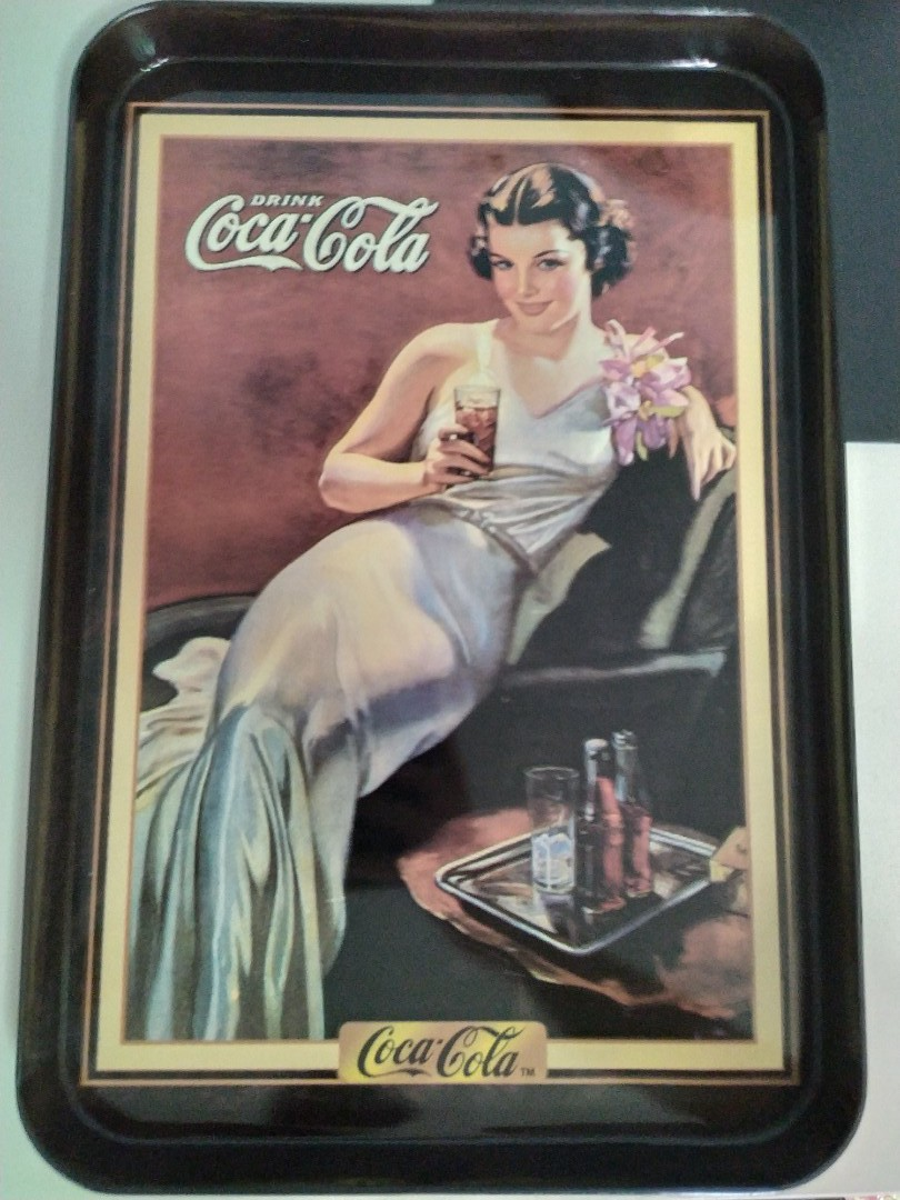 Vintage Coca Cola trays with retro design