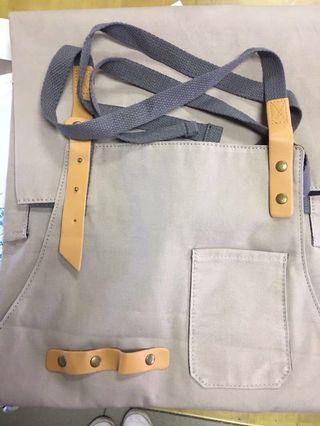 Khaki apron with faux leather straps