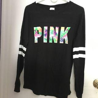 black, open-back long-sleeve