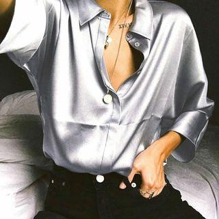 Satin silver shirt.
