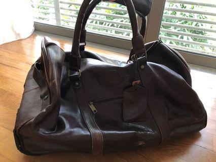 Dark brown leather bag with wheels