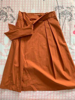 Korean midi bow skirt in burnt orange