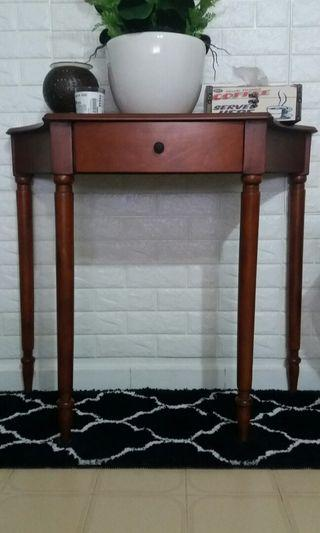 Wooden display table with drawers.