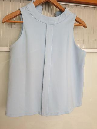 Light blue sleeveless top