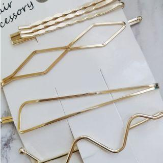 gold - colored hairclips