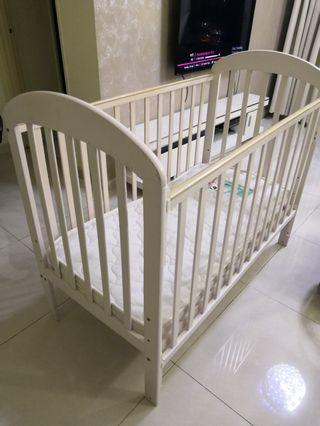 Wooden white cot with quality bed