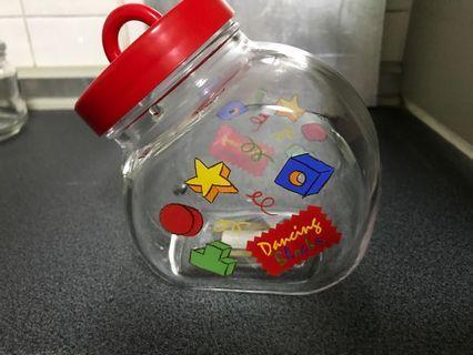 Tilted opening glass jar