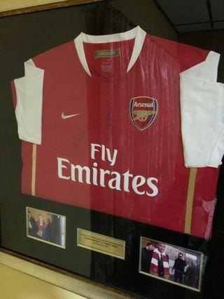 Original framed Arsenal jersey autographed by Thierry Henry and Arsene Wenger!