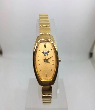 Barrel shaped Gold Lady watch with Japanese movement