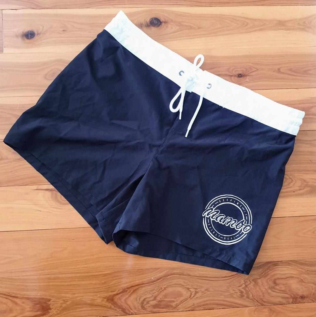 Women's size 12 'MAMBO' Gorgeous black with white elastic board shorts - AS NEW