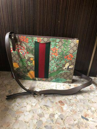 Gucci clutch with sling