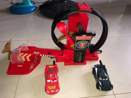 Sale of Pre-owned McQueen Piston Cup track with 2 walkie talkie McQueen and Jackson Storm as free gifts