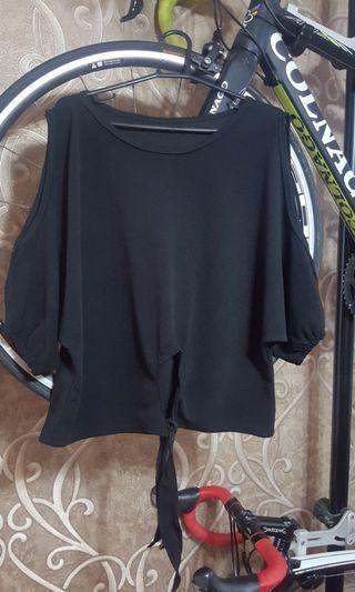 Plus size top with oval design cut @ shoulder and bottom.
