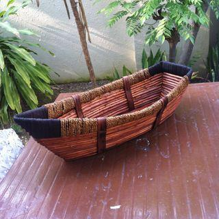 Rattan Boat basket. Dimension 65 x 25cm with height varying from 15cm to 20cm.