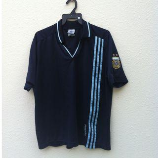 Genuine Adidas Dark Blue T shirt. Size US large. In good condition.