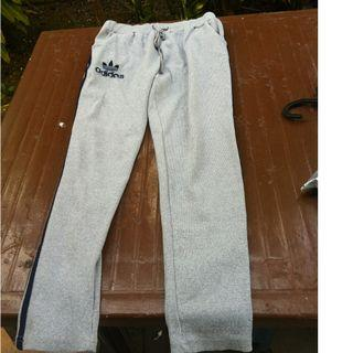 Adidas track pants.  Length 85cm width measured from waist is 30 to 36cm. In good condition.