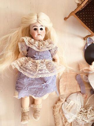 Antique doll with unique design costume