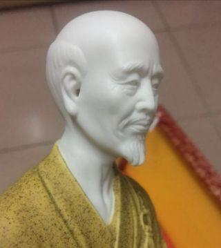 A white porcelain monk. 20cm H.