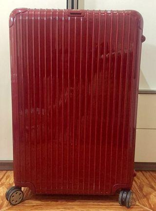 """RIMOWA's Red Salsa Deluxe 32"""" Multiwheel"""