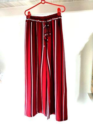 RED STRIPED MINIMALIST PALAZZIO PANTS WITH STRERCHABLE ELASTIC WAIST BAND! VERY COMFY MATERIAL! ONLY WORE LESS THAN 5TIMES, IN VERY GOOD CONDITION! CAN MATCH WITH TSHIRT OR CROP TOP! GOOD MATERIAL FOR THIS HUMID WEATHER! CREPE FABRIC MATERIAL! ONLY 1