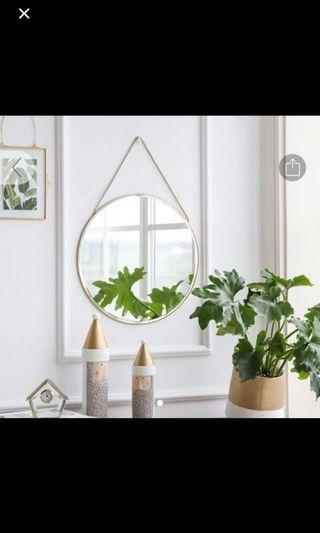 Gold rimmed hanging round vanity mirror with gold chain
