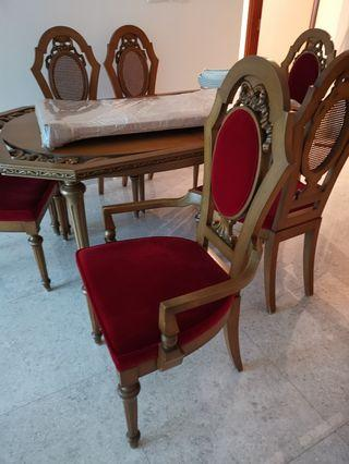 Antique wooden table with design at the corner