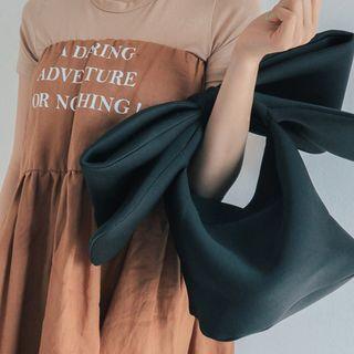 Ribbon Hand Held Bag