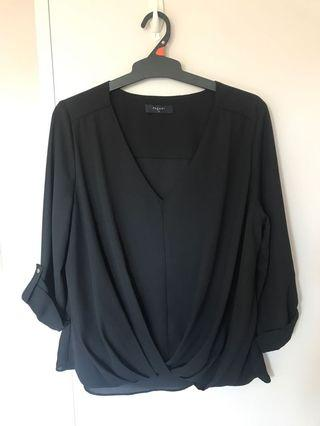 V-neck black top