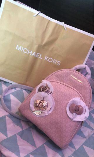 Bnew Michael Kors Abbey Medium Backpack Limited ed (Ballet color)