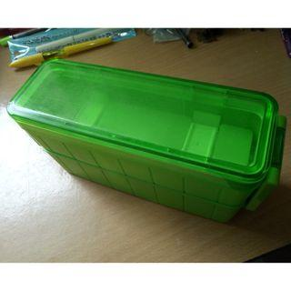Green bento box with chopsticks and hot/cold pack