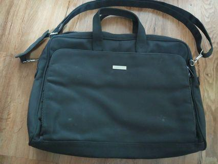 Likely used Laptop document computer Bag